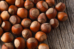 Hazelnuts on rustic wooden table Stock Photos