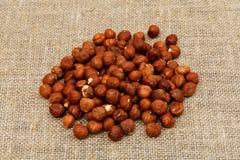 Hazelnuts on sackcloth Stock Photos
