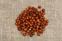Hazelnuts on sackcloth Royalty Free Stock Photos