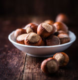Hazelnuts in a small bowl Royalty Free Stock Image