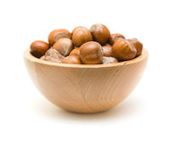 Hazelnuts in small wooden bowl Stock Image