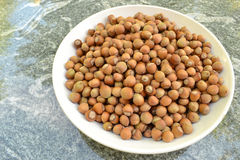 Hazelnuts in a white bowl Stock Photos