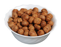 Hazelnuts on a white plate, isolated. Stock Photography