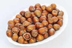 Hazelnuts on a white tray Stock Photography