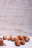 Hazelnuts on white wooden background Royalty Free Stock Photos