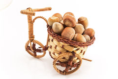 Hazelnuts in a wicker basket Stock Photography
