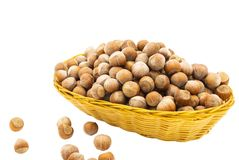 Hazelnuts in a wicker basket. Isolate on white background stock photos