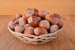 Hazelnuts in a wicker punnet Stock Photography