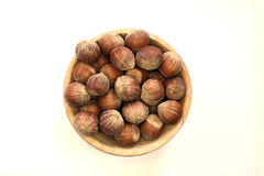 Hazelnuts on the withe background in study Stock Photos
