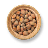 Hazelnuts in wood plate Royalty Free Stock Photos