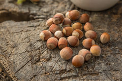 Hazelnuts. On a wooden  background Royalty Free Stock Photos