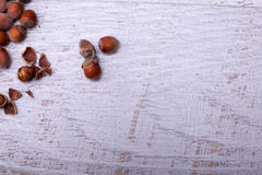 Hazelnuts on wooden background. Over top view Stock Image