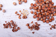 Hazelnuts on wooden background. Over top view Royalty Free Stock Image