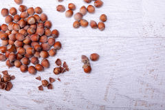 Hazelnuts on wooden background. Over top view Royalty Free Stock Images