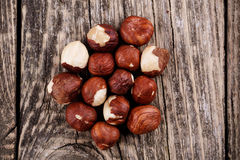 Hazelnuts on a wooden background. Some hazelnuts on a wooden background stock images
