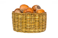 Hazelnuts in wooden basket Stock Photos