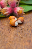 Hazelnuts on wooden board Stock Images