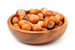 Hazelnuts in wooden bowl closeup. Hazelnuts in wooden bowl closeup on white Stock Photography
