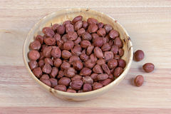 Hazelnuts in a wooden bowl Royalty Free Stock Photo