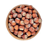 Hazelnuts in a wooden bowl on a white background Royalty Free Stock Image