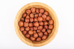 Hazelnuts in wooden bowl. View from above Stock Photos