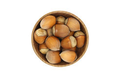 Hazelnuts in a wooden bowl Stock Photos