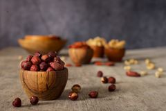 Hazelnuts in a wooden bowl. stock images