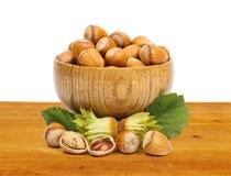 Hazelnuts in wooden pot Stock Photo