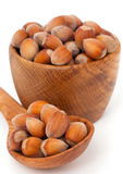Hazelnuts in a wooden spoon and bowl Royalty Free Stock Photography