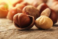 Hazelnuts on wooden table Stock Images