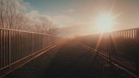 Sunset Haze Bridge. A hazey sunset above a bridge over a motorway. Beautiful colours in the sky Stock Photo