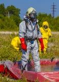 Hazmat队员穿着防护套服 免版税图库摄影