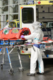 HAZMAT medical team member with stretcher Royalty Free Stock Photo