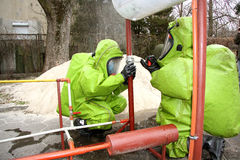 Hazmat response team in action. Hazmat (hazardous material) response team in action; trying to stop a leak of a dangerous chemical substance Royalty Free Stock Photo