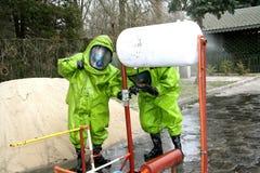 Hazmat response team stopping a leak stock image