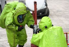 Hazmat response team at work. Hazmat (hazardous material) response team in action; fighting a leak of a dangerous chemical substance Royalty Free Stock Images