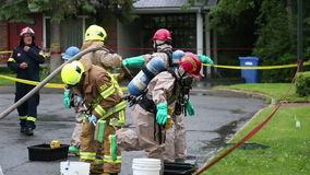 Hazmat team decontamination washing process.