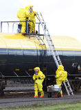 HAZMAT Team Divides To Conquer. Fire departments and emergency response teams will conduct disaster preparedness drills. These HAZMAT team members working from Royalty Free Stock Photography