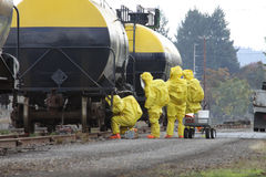 HAZMAT Team Members Checks For Leaks. In any urban area the fire departments and emergency response teams will conduct disaster preparedness drills. These HAZMAT Stock Photo
