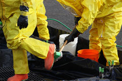 HAZMAT Team Members Clean Up Boots. Fire departments and emergency response teams will conduct disaster preparedness drills. These HAZMAT team members have been Royalty Free Stock Images