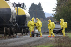 HAZMAT Team Members Discusses Chemical Disaster. In any urban area the fire departments and emergency response teams will conduct disaster preparedness drills Stock Photos