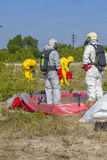 Hazmat team members have been wearing protective suits to protect them from hazardous materials Stock Images