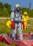 Hazmat team members have been wearing protective suits Royalty Free Stock Photography