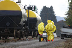 HAZMAT Team Members Investigate Chemical Disaster. In any urban area the fire departments and emergency response teams will conduct disaster preparedness drills royalty free stock image