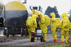 HAZMAT Team Members Suited Up For Disaster Drill Royalty Free Stock Photos