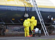 HAZMAT Team Passes Up Tools. Fotografia Stock Libera da Diritti
