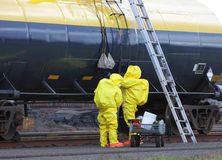 HAZMAT Team Passes Up Tools. Royalty Free Stock Photo