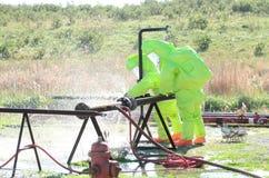 Hazmat team stopping leak. A hazmat team practicing stopping a leak Stock Photo