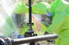 Hazmat team stopping leak stock photos