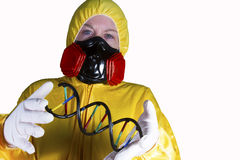 HazMat Worker with Double Helix. Woman dressed in HazMat suit with gas mask and shield with Royalty Free Stock Photography